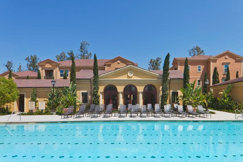 Exterior view of pool at Umbria Apartment Homes at Cypress Village in Irvine, CA.