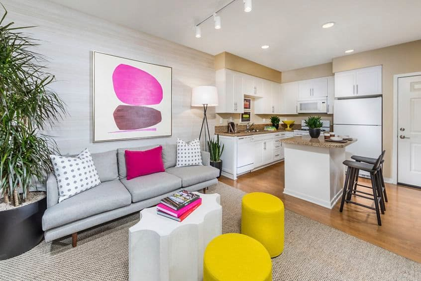 Interior view of living and dining at Umbria Apartment Homes at Cypress Village in Irvine, CA.