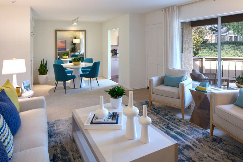 Interior view of living room and dining room atDeerfield Apartment Homes in Irvine, CA.