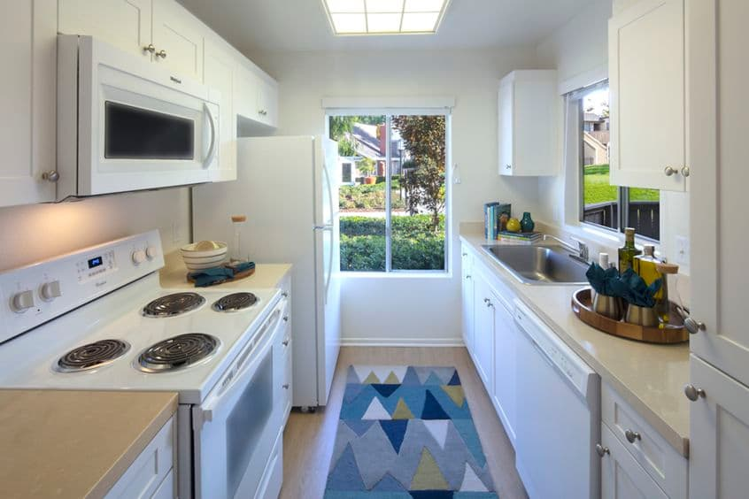 Interior view of kitchen at Deerfield Apartment Homes in Irvine, CA.
