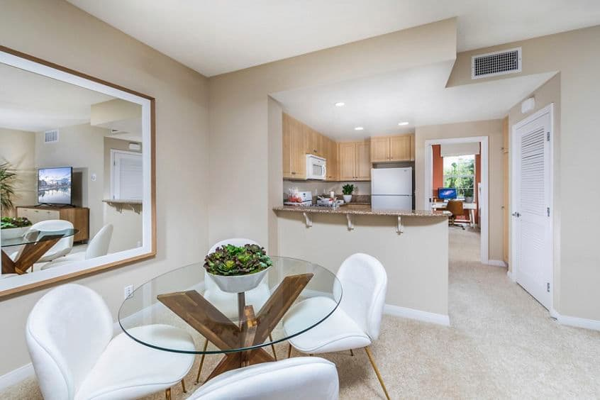 Interior view of  living and dining at Esperanza Apartment Communities in Irvine, CA.