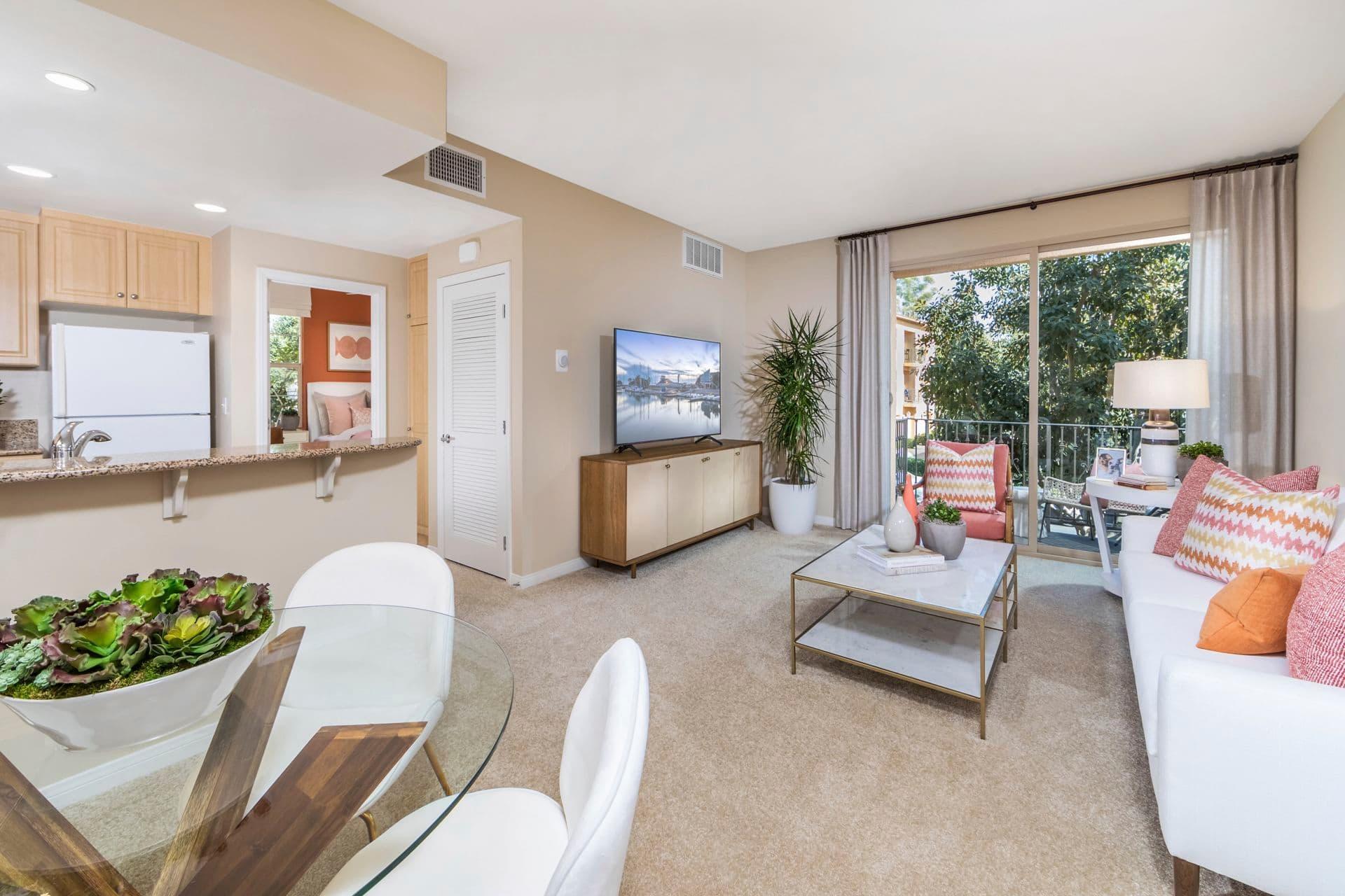 Interior view of  living and dining at Esperanza Apartment Communities in Irvine, CA.