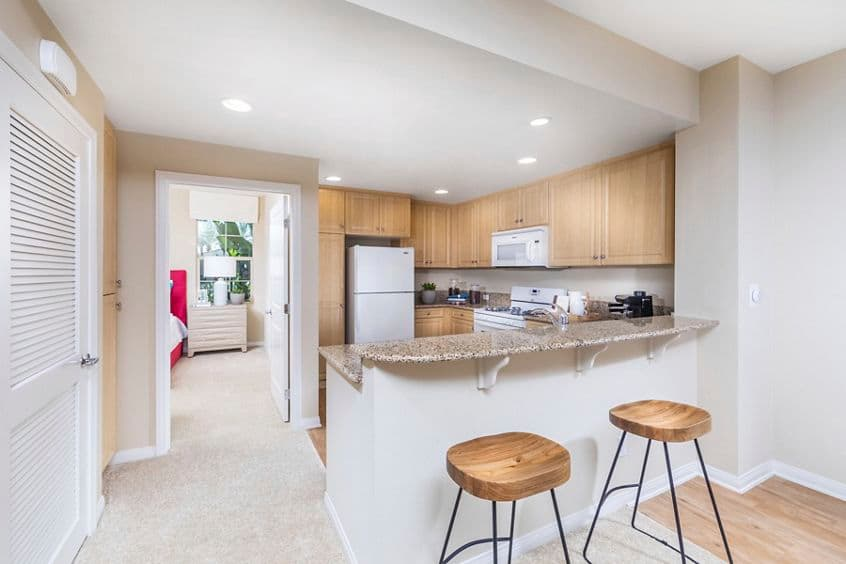 Interior view of  kitchen at Esperanza Apartment Communities in Irvine, CA.