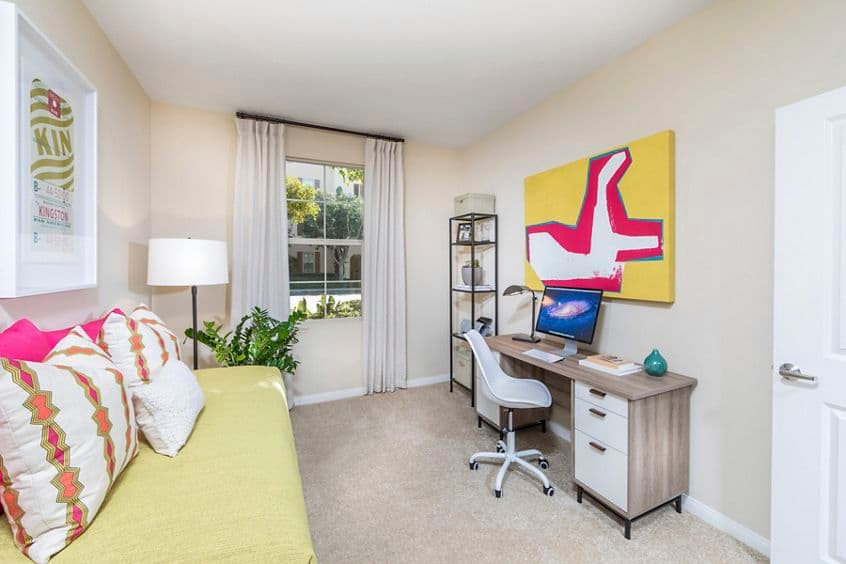 Interior view of  bedroom with office space at Esperanza Apartment Communities in Irvine, CA.