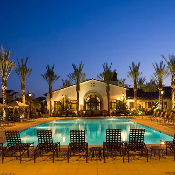 Night time pool view at Esperanza Apartment Homes in Irvine, CA.