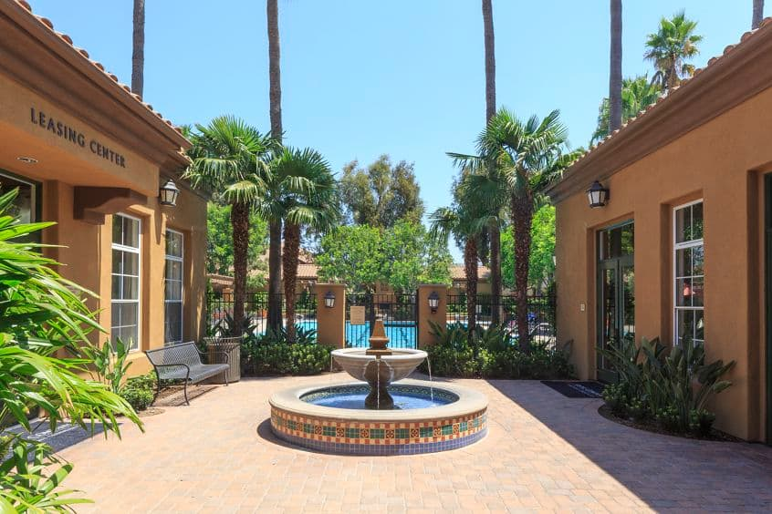 Exterior view of fountain at Estancia Apartment Homes in Irvine, CA.