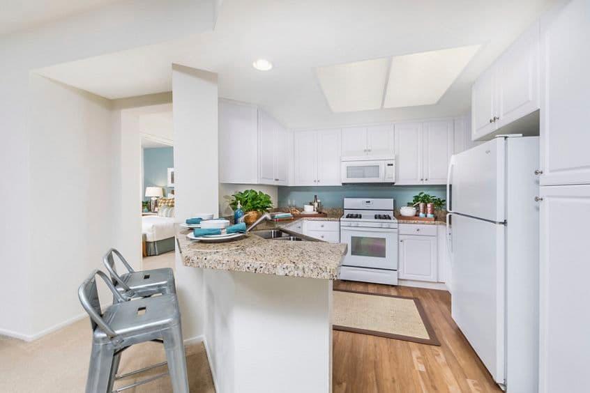 Interior view of kitchen at Estancia Apartment Homes in Irvine, CA.