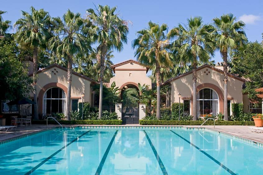 Exterior view of pool at Estancia Apartment Homes in Irvine, CA.