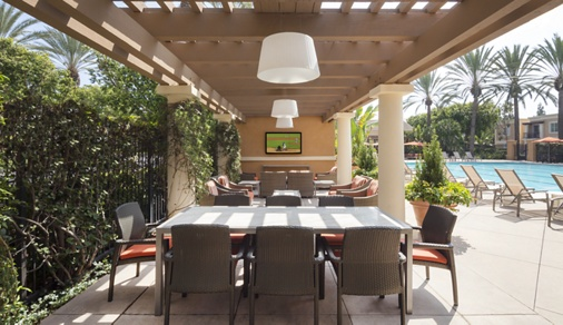 Exterior view of pool patio at Las Palmas Apartment Homes in Irvine, CA.