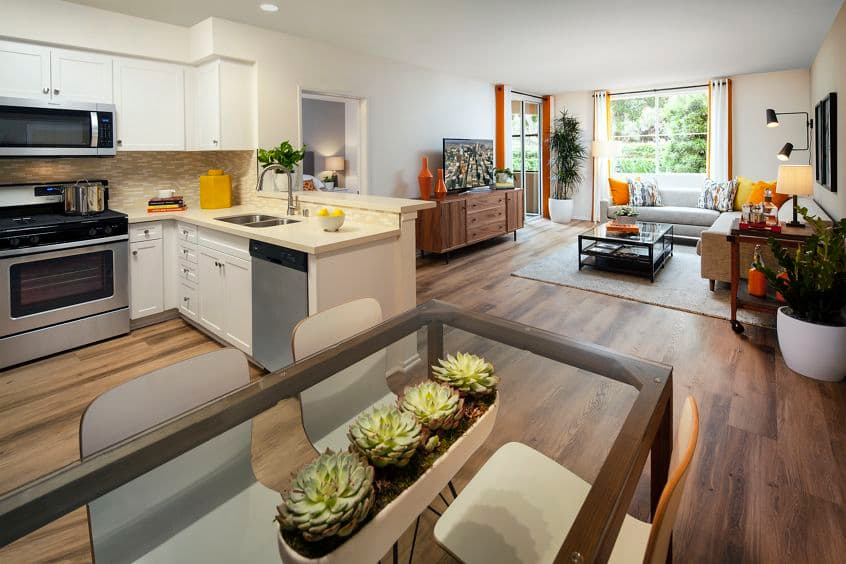 Interior view of kitchen, living room, and dining room at Las Palmas Apartment Homes in Irvine, CA.