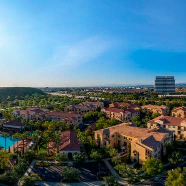 Exterior aerial panorama view of trailside at Los Olivos at Irvine Spectrum Apartment Homes in Irvine, CA.