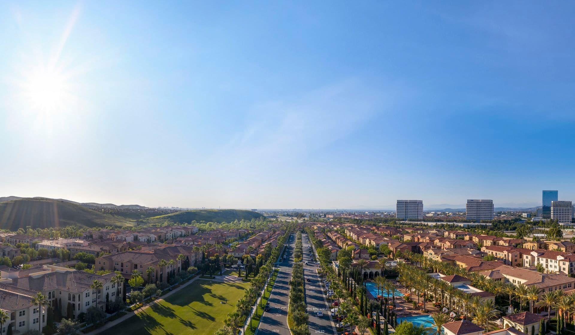 Exterior aerial panorama view of leasing center at Los Olivos at Irvine Spectrum Apartment Homes in Irvine, CA.