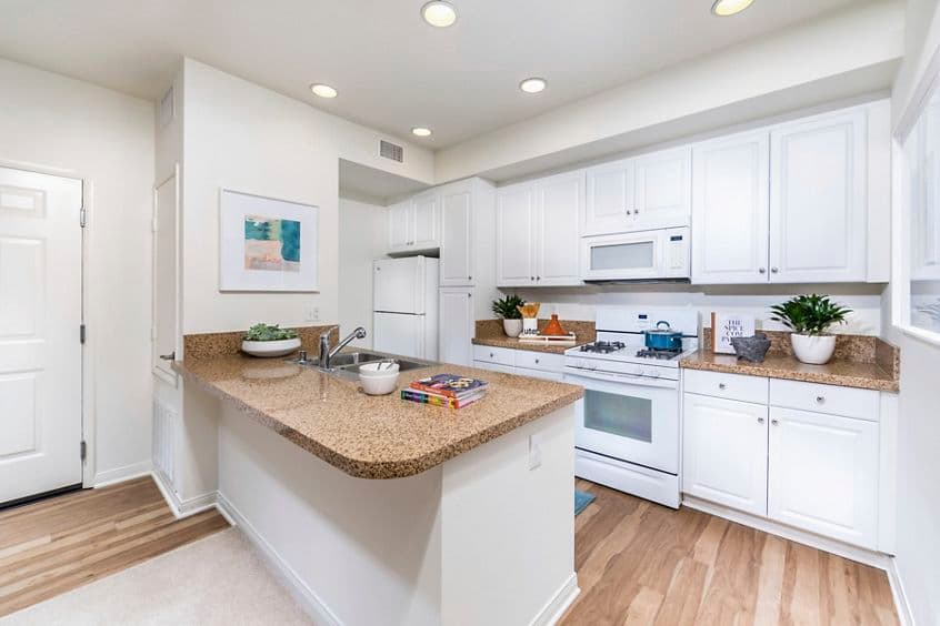 Interior view of kitchen at Los Olivos Apartment Homes at Irvine Spectrum in Irvine, CA.