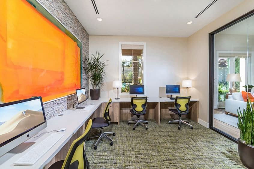 Interior view of iLounge business center at Los Olivos Apartment Homes at Irvine Spectrum in Irvine, CA.