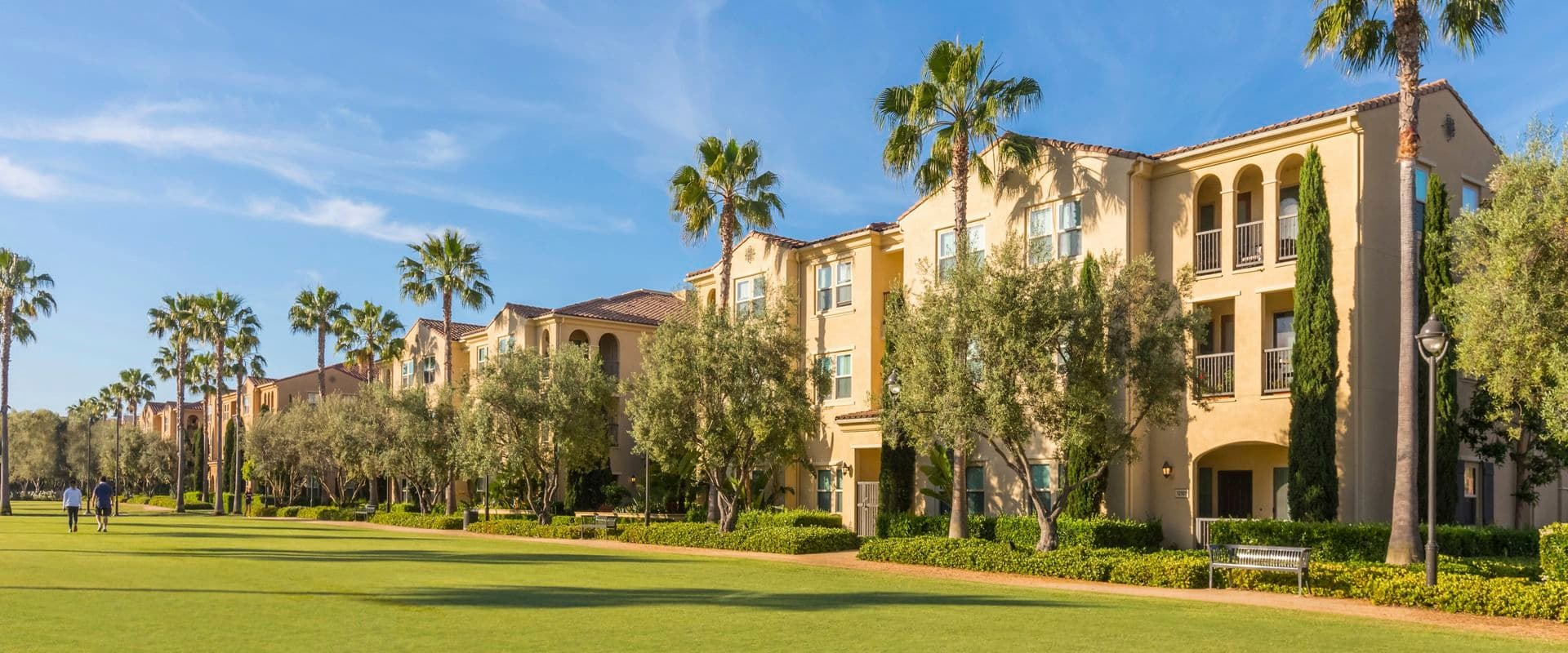 Exterior view of open space at Los Olivos at Irvine Spectrum Apartment Homes in Irvine, CA.