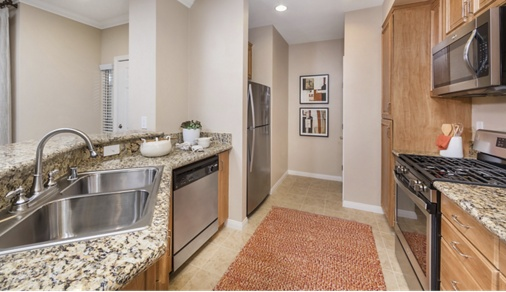 Interior view of kitchen at Mirasol Apartment Homes in Stonegate, Irvine, CA.