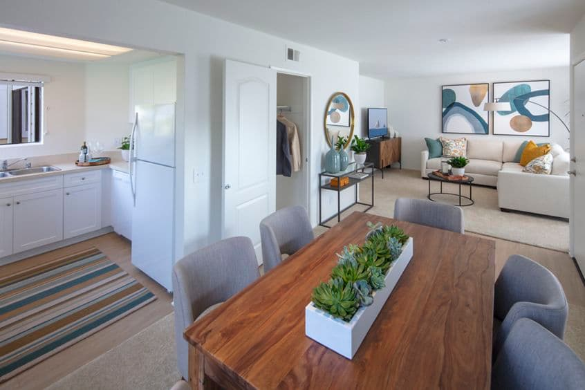 Interior view of dining room, living room and kitchen at Northwood Park Apartment Homes in Irvine, CA.