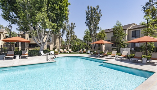 Exterior view of pool at Northwood Place Apartment Homes in Irvine, CA.