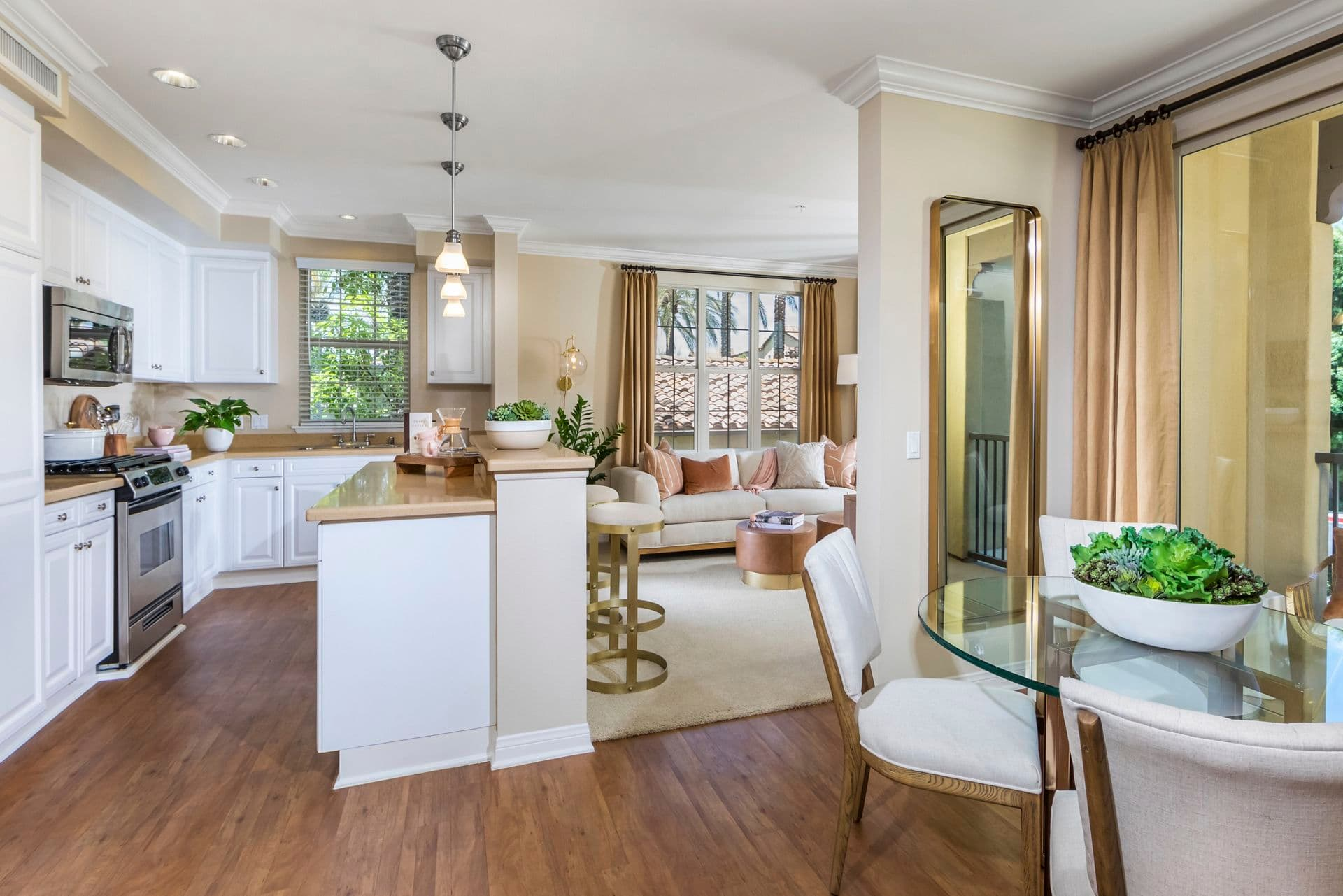 Interior view of kitchen and dining room at Orchard Hills Apartment Homes in Irvine, CA.