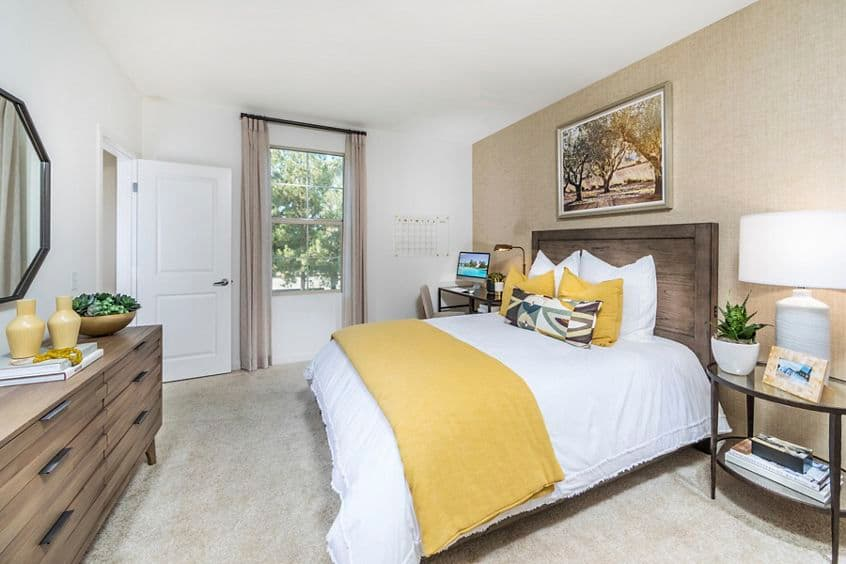 Interior view of  bedroom at Palmeras Apartment Home in Irvine, CA.