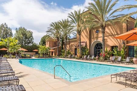 Exterior view of pool at Palmeras Apartment Homes in Stonegate, Irvine,
