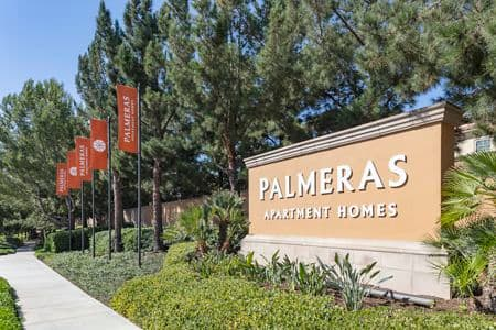 Exterior view of monument signage at Palmeras Apartment Homes at Stonegate in Irvine, CA