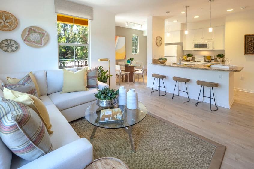 Interior view of kitchen, dining room and living room at Palmeras Apartment Homes in Irvine, CA.