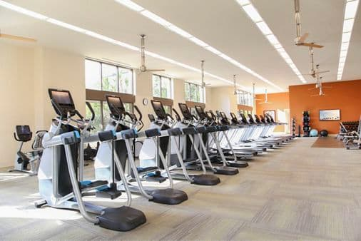 Interior view of fitness center at Park Place Apartment Homes in Irvine, CA.