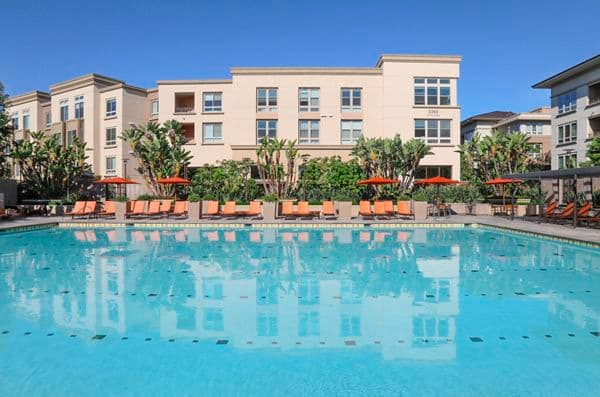 Exterior view of pool at Park Place Apartment Homes in Irvine, CA.