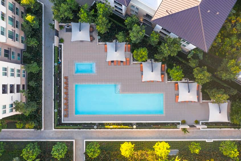 Aerial view of pool at Park Place Apartment Homes in Irvine, CA.