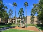 Exterior view of children's play area at Park West Apartment Homes in Irvine, CA.
