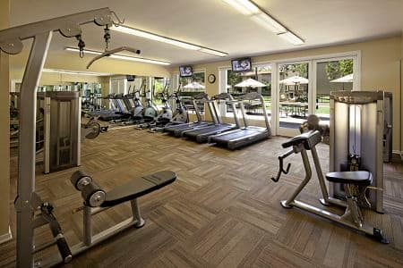 Interior view of fitness center at Park West Apartment Homes in Irvine, CA.