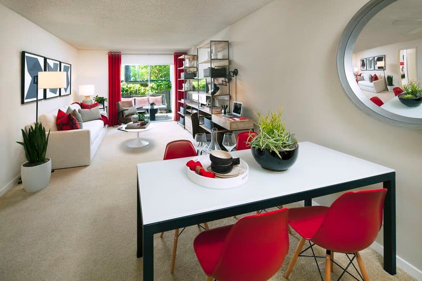 Interior view of living room and dining room at Park West Apartment Homes in Irvine, CA.
