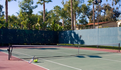 Exterior view of tennis court at Park West Apartment Homes in Irvine, CA.