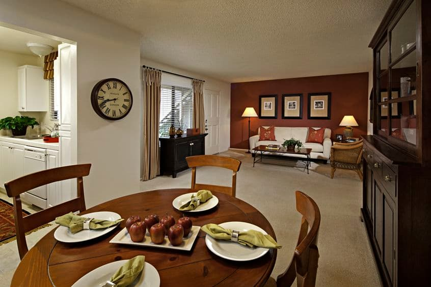 Interior view of dining room and living room at Parkwood Apartment Homes in Irvine, CA.