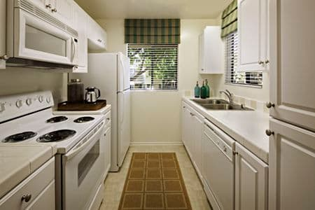 Interior view of kitchen at Parkwood Apartment Homes in Irvine, CA.
