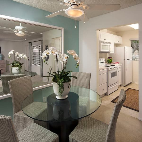Interior view of dining room and kitchen at Parkwood Apartment Homes in Irvine, CA.