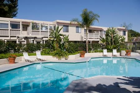 Exterior view of pool at Parkwood Apartment Homes in Irvine, CA.
