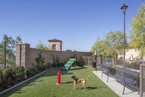 Exterior view of dog park at Portola Court Apartment Homes in Irvine, CA.