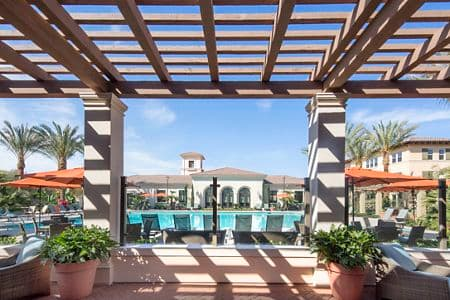 Exterior view of pool at Portola Court Apartment Homes in Irvine, CA.