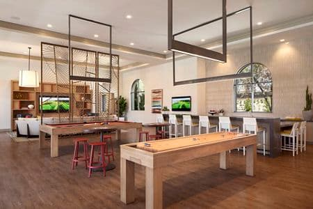 Interior view of clubhouse at Portola Court Apartment Homes in Irvine, CA.