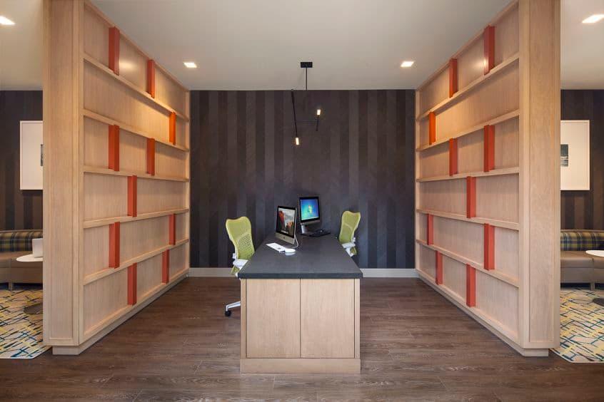 Interior view of iLounge business center at Portola Court Apartment Homes in Irvine, CA.