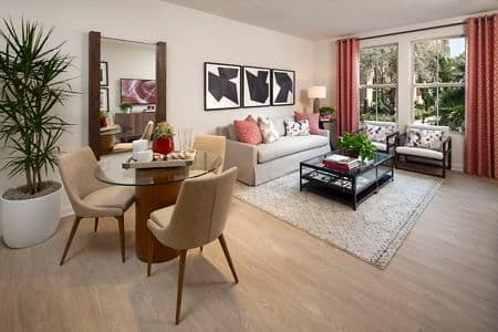 Interior view of living room and dining room at Portola Court Apartment Homes in Irvine, CA.