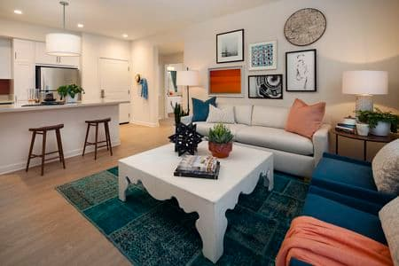 Interior view of living room and kitchen at Portola Court Apartment Homes in Irvine, CA.
