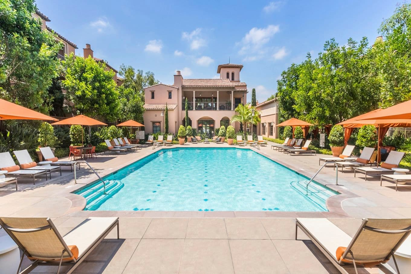 Exterior view of pool at Portola Place Apartment Homes in Irvine, CA.