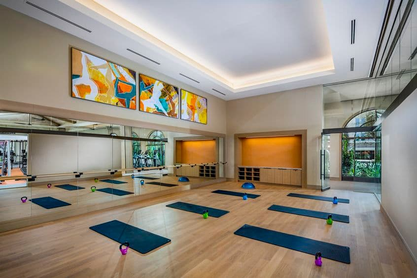 Interior view of yoga room at Promenade Apartment Homes in Irvine, CA.