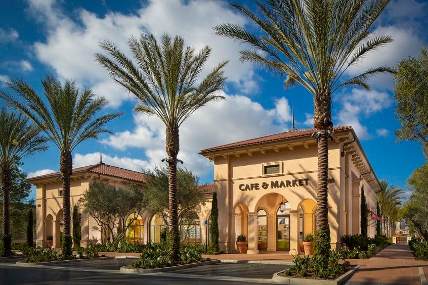 Exterior view of Cafe & Market at Promenade Apartment Homes in Irvine, CA.