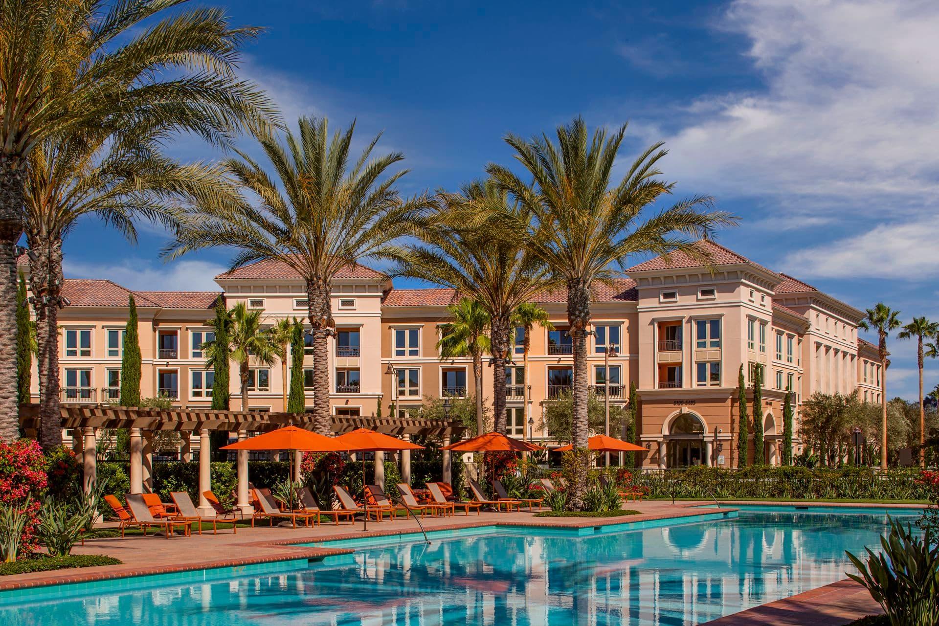Exterior view of pool at Promenade Apartment Homes in Irvine, CA.