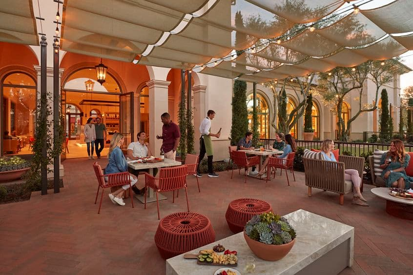 Exterior view of outdoor patio at Cafe & Market at Promenade Apartment Homes in Irvine, CA.