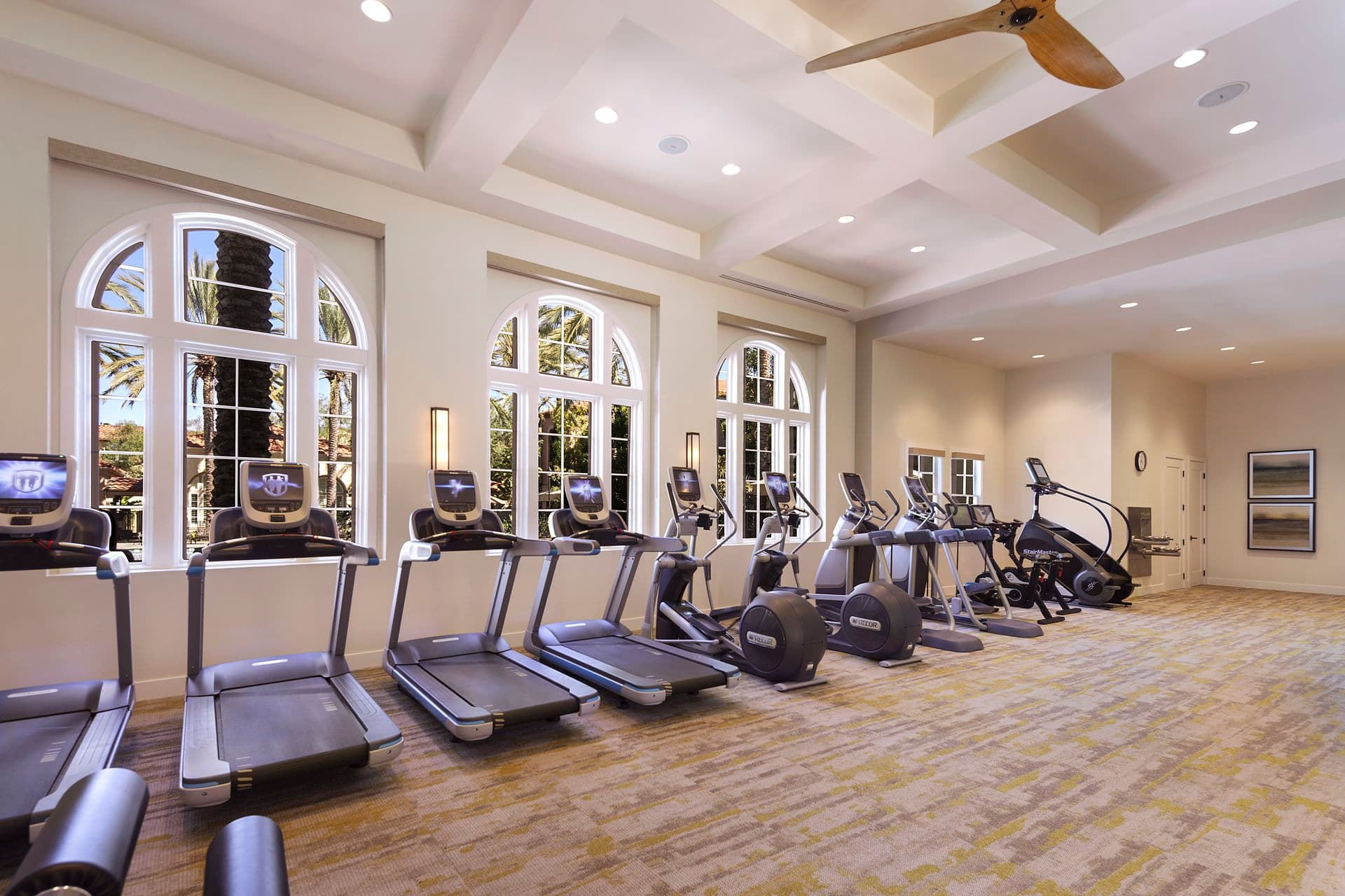 Interior view of fitness center at Quail Hill Apartment Homes in Irvine, CA.